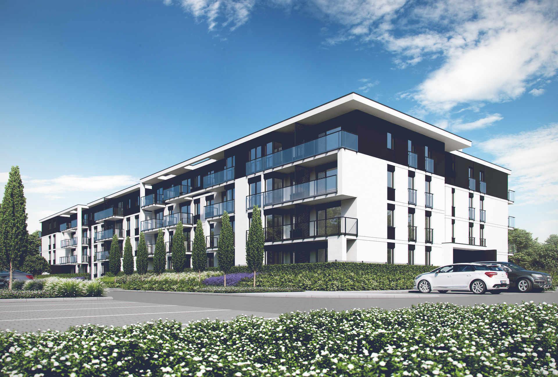Szaro-biała elewacja budynku szeregowego Home Premium z pochyłym dachem i ogrodem, przy ul. Prostej o zmierzchu.